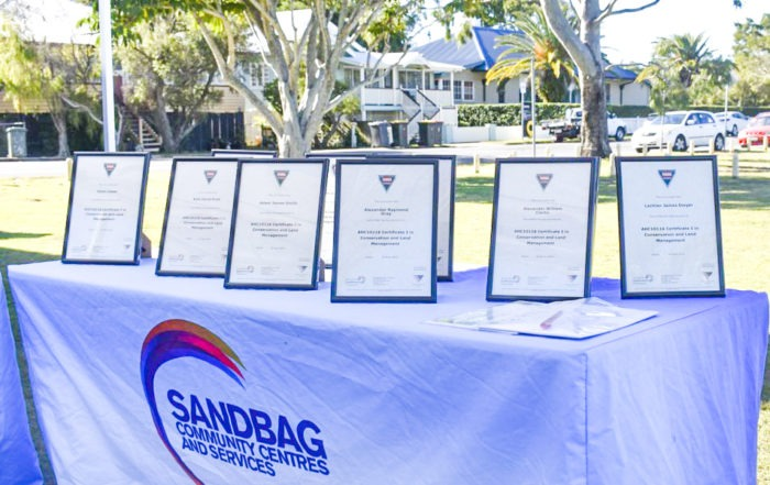 Framed Skilling Queenslanders for Work Certificates placed on Sandbag branded table